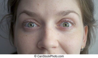 Caucasian woman rotating her green eyes, slow motion video
