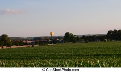 Summer landscape Panoramic view of maize field. Hot-air...