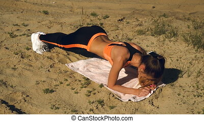 Athletic girl practiced a strap exercise outdoors - Athletic...
