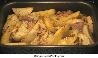 Cooking fried potatoes with pork in oven
