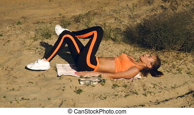 sports girl doing exercises for ABS - thin sports girl doing...