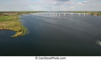 Aerial shot of a modern automobile bridge over the Dnipro...