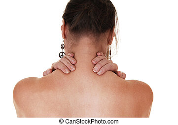 Girl with neck pain. - A woman standing with her back to the...