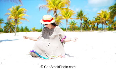 Young beautiful woman on tropical beach with palmtrees -...