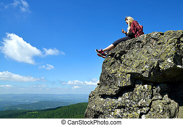 Girl at the top of Grosser Arber mountain in National park...