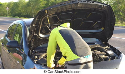 man repair under the hood of car