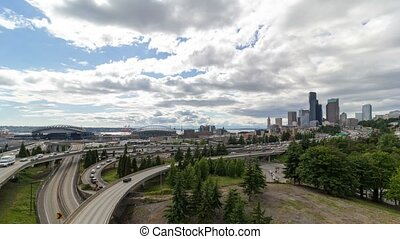 Time lapse of clouds over Seattle Wa city skyline and...