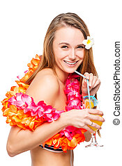 Portrait of a girl with a glass of cocktail in a Hawaiian...