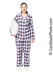 Happy woman in pajamas with a pillow in full length ready to...