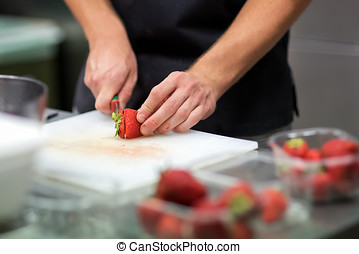 Chef preparing fresh tropical fruit salad