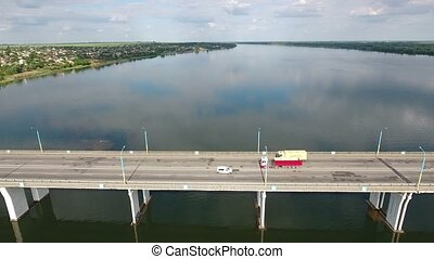 Aerial shot of a car bridge with a big truck and a bus...