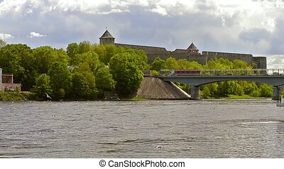 Ivangorod fortress stand on banks of Narva river. Seagulls...