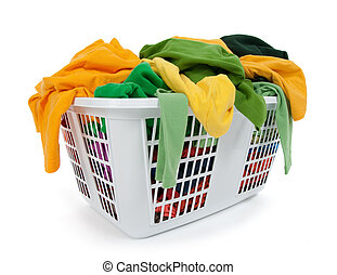 Bright clothes in laundry basket. Green, yellow.