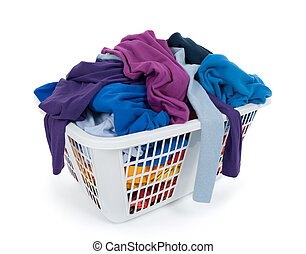 Bright clothes in laundry basket Blue, indigo, purple -...