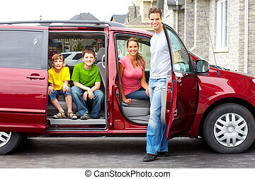 Family car - Smiling happy family and a family car