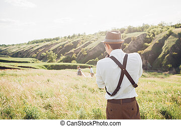 wedding photographer takes pictures of bride and groom in nature, fine art photo