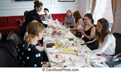 Women met for breakfast. French lesson for adults