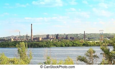 Panorama of an industrial plant by the river Dnipro