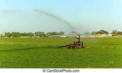 Watering machine in the field - Crop Irrigation using the...
