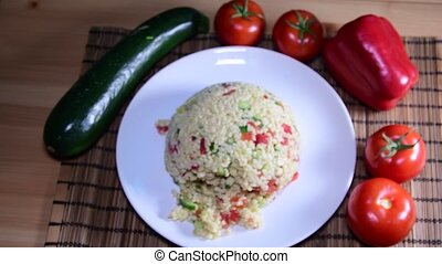Bulgur also burghul with vegetables. Flat view of bulgur....