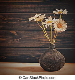 Daisy flowers, beauty still life against old wooden desk