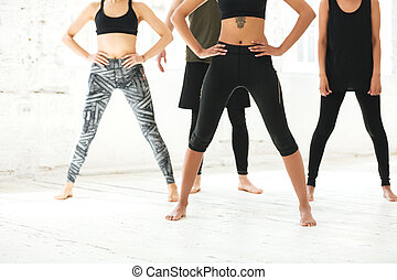 Cropped image of a mixed group of people exercising together...