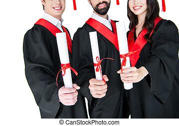 tiro,  diplomas, estudiantes, graduación, cortado, tenencia, vestidos, sonriente, blanco