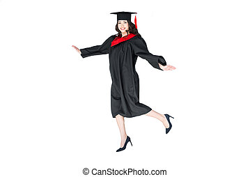 attractive student in graduation cap with diploma jumping...