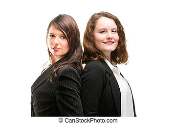 Two young business women in full li