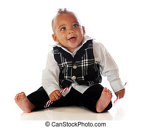 Happy Bi-racial Baby - A dressed-up biracial baby happily...