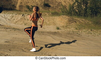 girl warmed up before exercise jogging on the spot