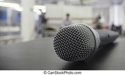 Dynamic vocal microphone on stage, close-up view