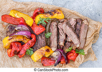Beef Fajitas with colorful bell peppers on a table - Grilled...