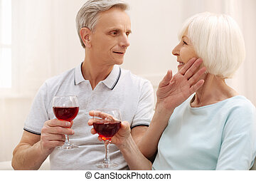 Emotional aged couple sharing an intimate moment - Love of...