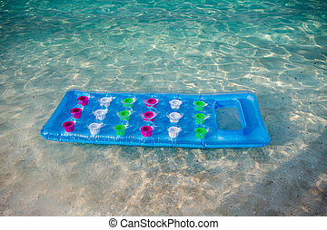 Inflatable mattress in seawater - Colorful inflatable...