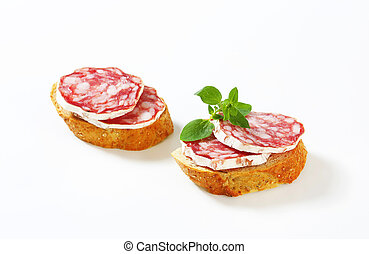 Saucisson Sec canapes - Canapes with slices of French dry...