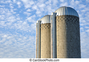Two Concrete Stave Silos - A Pair of Farm Silos Against a...