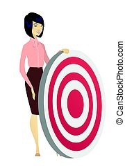 Young business woman and dart board. - Asian business woman...