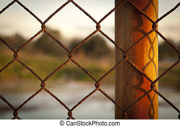 Rusted Fence - Rusty wire fence (cylcone fencing) in...