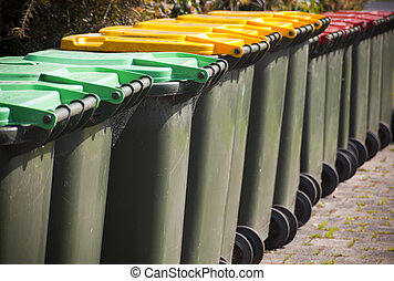 Wheelie Bins - Row of large green wheelie bins for rubbish