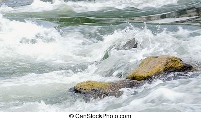 Cascade of the mountain river. Water flowing through rock in...