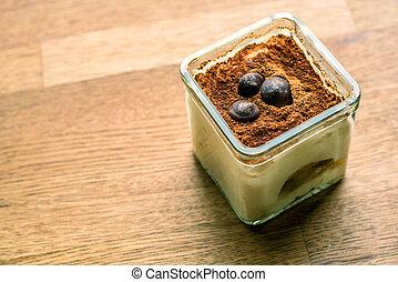 Tiramisu in glass cup - Tiramisu dessert in a glass cup on a...