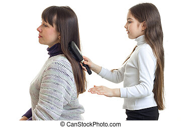 girl combing hair to her mum isolated on white background