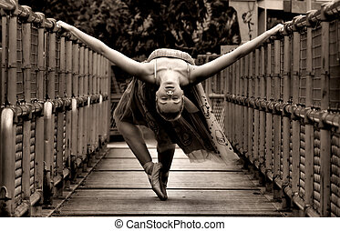 Ballerina fine art - ballerina posing on a bridge in sepia