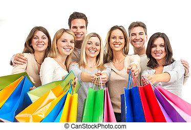 Shopping women - Happy shopping women. Isolated over white...