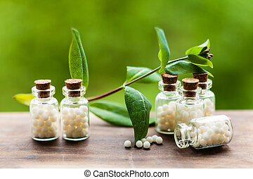 Homeopathy pills in vintage bottles
