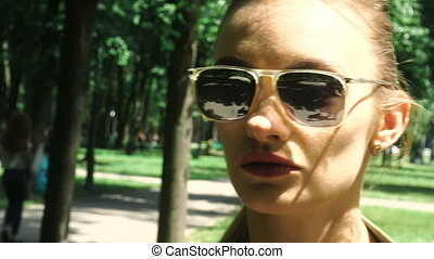 Close up of beautiful young lady in sumglasses with red lips...