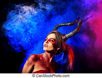 Mad satan woman on black magic ritual of in hell. Witch...