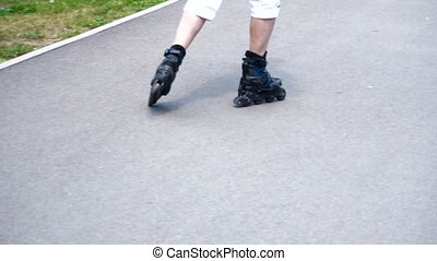 Guy rollerblading in the Park