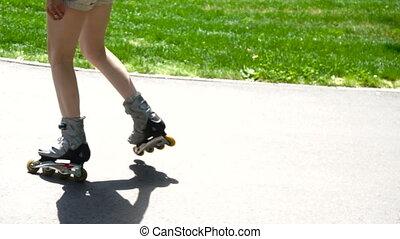 girl ride on roller skates in the Park